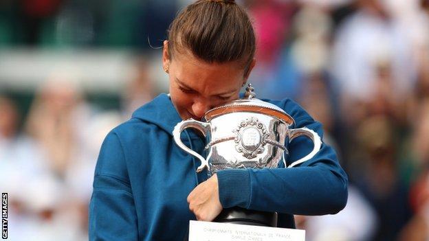 Simona Halep hugs her trophy