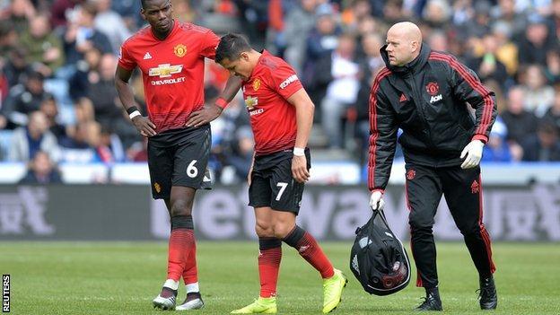 Alexis Sanchez limps off the field against Huddersfield