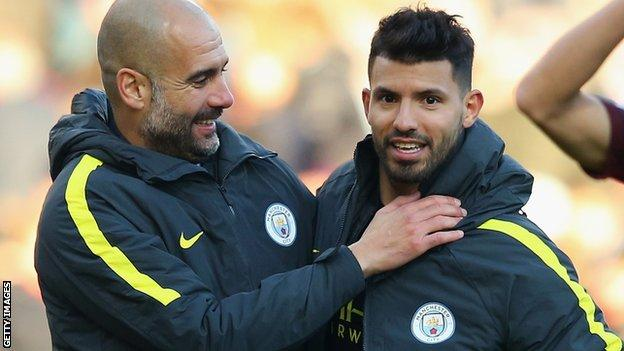Manchester City manager Pep Guardiola (left) and striker Sergio Aguero