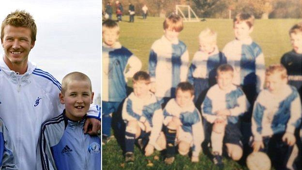 A young Harry Kane poses for a photograph with David Beckham