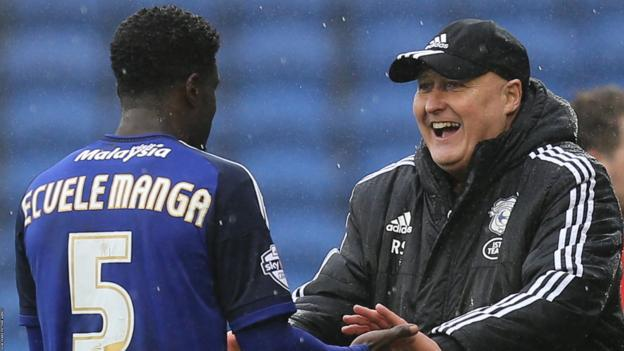 Russell Slade (right) celebrates Cardiff's win against Brighton with Bruno Ecuele Manga