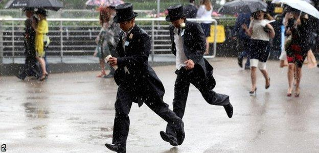 Punters make a dash for it in the rain at Royal Ascot