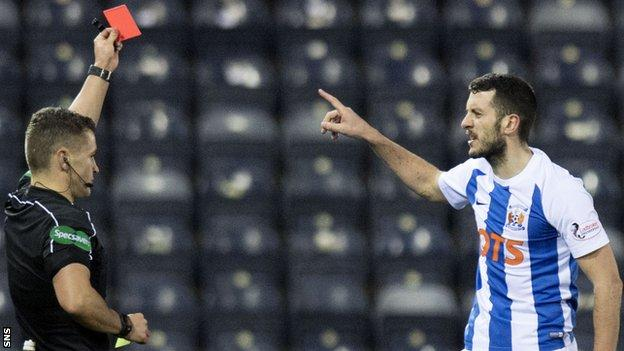 Referee Nick Walsh sends off Kilmarnock midfielder Gary Dicker