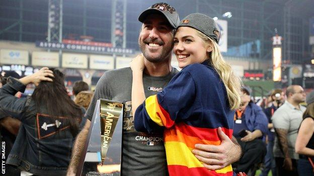 Houston Astros pitcher Justin Verlander with fiancee Kate Upton and the MVP trophy