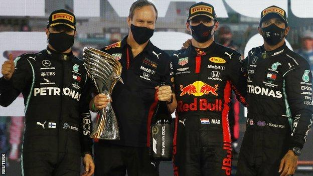 Mercedes duo Valtteri Bottas and Lewis Hamilton with Red Bull's Max Verstappen after the Abu Dhabi Grand Prix