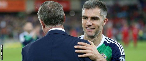 Northern Ireland manager Michael O'Neill and Aaron Hughes celebrate beating Czech Republic
