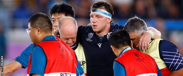 Scotland flanker Hamish Watson is helped from the field injured