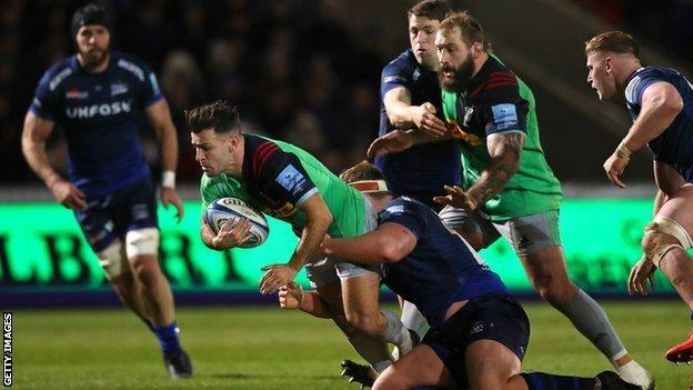Danny Care of Harlequins is tackled by Ross Harrison of Sale Sharks during a Premiership Rugby match