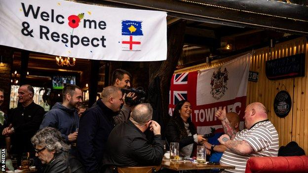 England fans have been the focus of fond attention in Pristina, including from the media