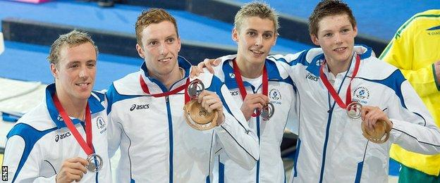 Robbie Renwick, Dan Wallace, Stephen Milne and Duncan Scott with their Commonwealth Games silver medals