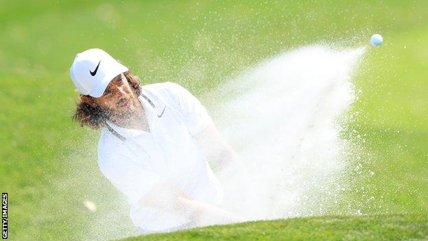 Tommy Fleetwood hits out of a bunker during round one of the Players Championship at Sawgrass