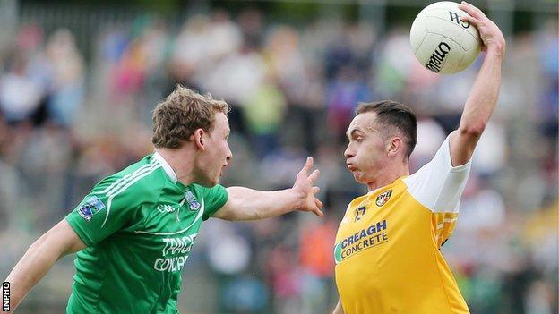 Fermanagh's Aiden Breen attempts to close down Antrim forward Brian Neeson