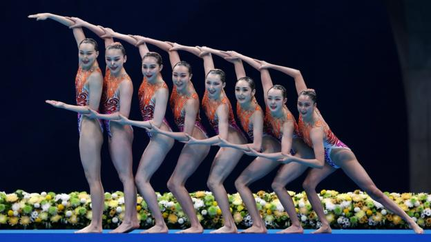 Team China compete in the Artistic Swimming