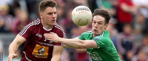 Westmeath's Kieran Gavin in action against Tomás Corrigan of Fermanagh