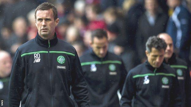 Celtic manager Ronny Deila, coach John Kennedy and assistant boss John Collins cut disconsolate figures at the end of the defeat at Pittodrie