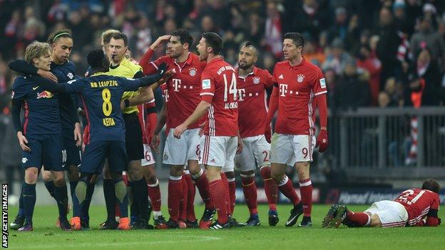 Emil Forsberg is led away by team-mates shortly before being shown the red card