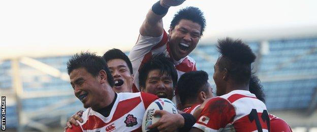Japan celebrating victory over South Africa