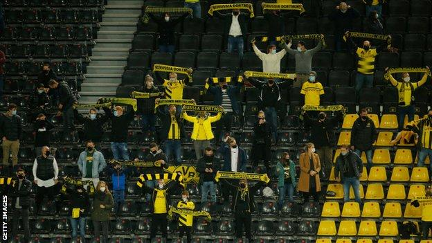 Borussia Dortmund fans support their side during a game against Schalke