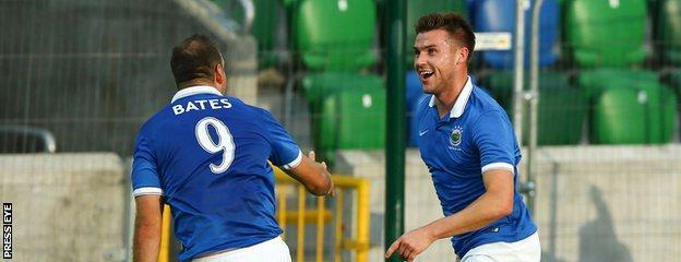 Guy Bates congratulates Linfield goalscorer Stephen Lowry