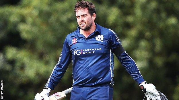 Scotland's Calum MacLeod celebrates his century against Afghanistan