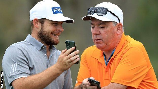 Tyrrell Hatton and caddy Mick Donaghy