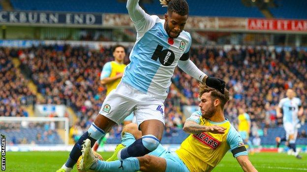 Blackburn Rovers' Kasey Palmer is tackled by Rotherham United's Joe Mattock