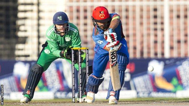 Afghanistan's Gulbadin Naib in action against Ireland