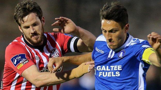 Derry skipper Ryan McBride challenges Shane Duggan of Limerick