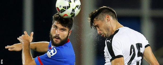 Caley Thistle's Dani Lopez beats Astra's Valerica Gaman in the air