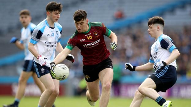 Oisin Smyth of St Ronan's in possession against Rice College's Luke Dawson during the Hogan Cup final