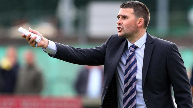Northern Ireland's record scorer David Healy took charge of Linfield for the first time on Saturday against Warrenpoint Town
