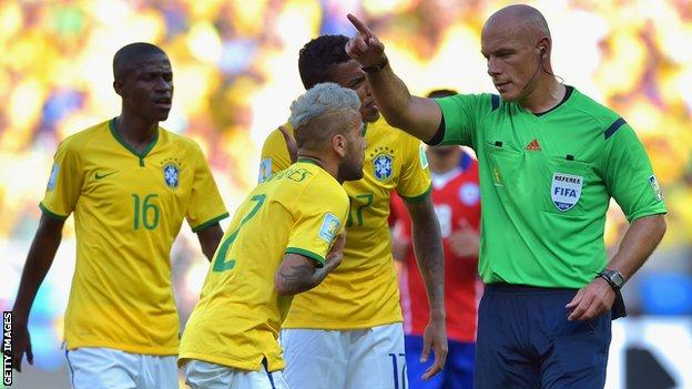 Dani Alves of Brazil reacts as referee Howard Webb calls a foul during the 2014 FIFA World Cup Brazil