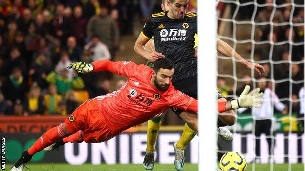 Rui Patricio of Wolves makes a save against Norwich