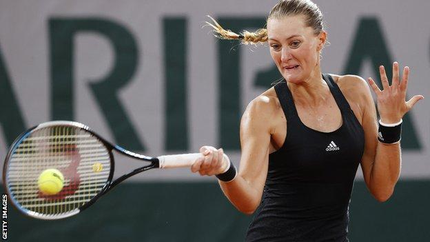Kristina Mladenovic hits a forehand