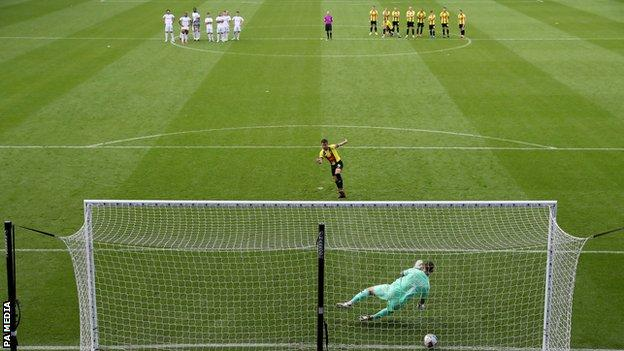 Harrogate Town captain Josh Falkingham scores the winning penalty against Tranmere Rovers
