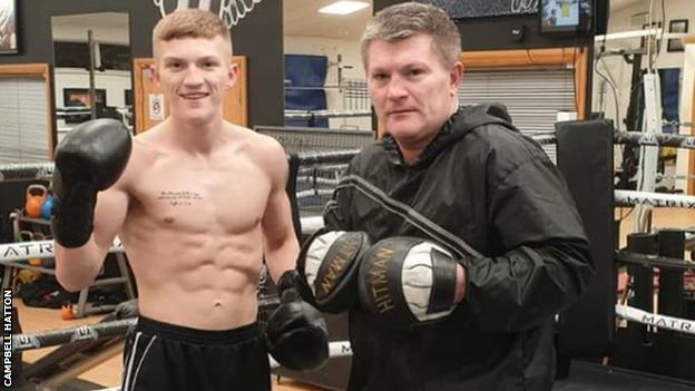 Campbell Hatton (left) in the gym with father Ricky Hatton (right)