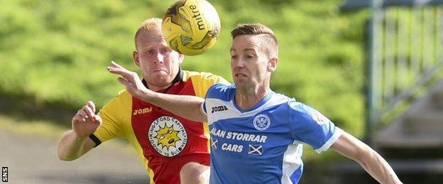 St Johnstone's Steven MacLean shields the ball from Partick's Ziggy Gordon