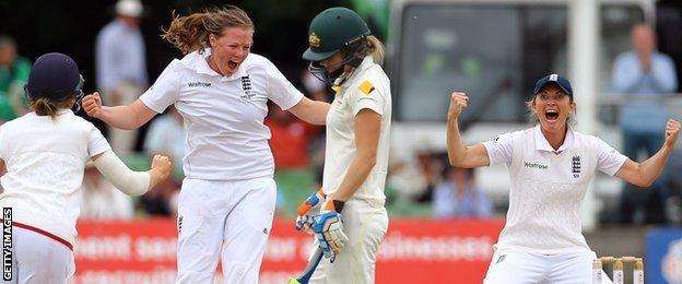 England celebrate taking an Australian wicket