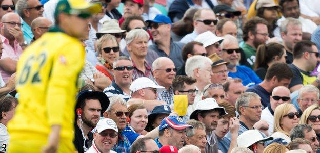 Some spectators goaded Australia's cricketers by waving sandpaper cards