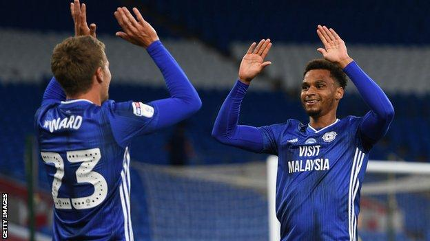 Danny Ward celebrates with Josh Murphy after scoring Cardiff's thrid goal against Hull