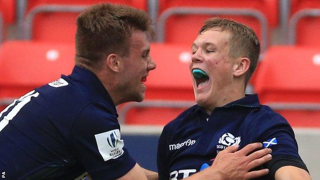 Darcy Graham (right) celebrates his winning try against Australia