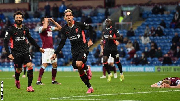 Roberto Firmino (centre) celebrates scoring for Liverpool at Burnley