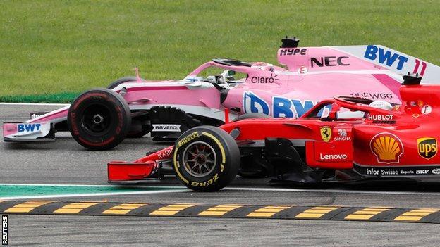 Sebastian Vettel passes Sergio Perez