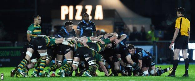Glasgow Warriors and Northampton Saints pack down for a scrum at Scotstoun