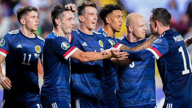 Scotland players celebrate John McGinn's (second left) goal