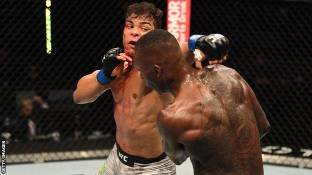 Nigeria-born Israel Adesanya (right) avoids a punch from Paulo Costa at UFC 253