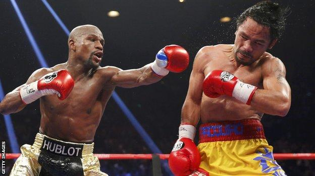 Floyd Mayweather fighting against Manny Pacquiao