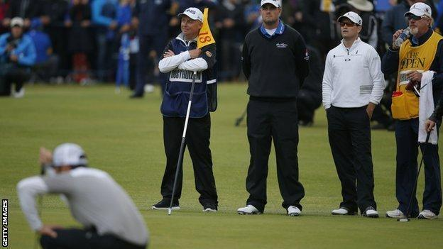 Miguel Angel Jimenez and Retief Goosen search for a ball at the Open Championship, 2009