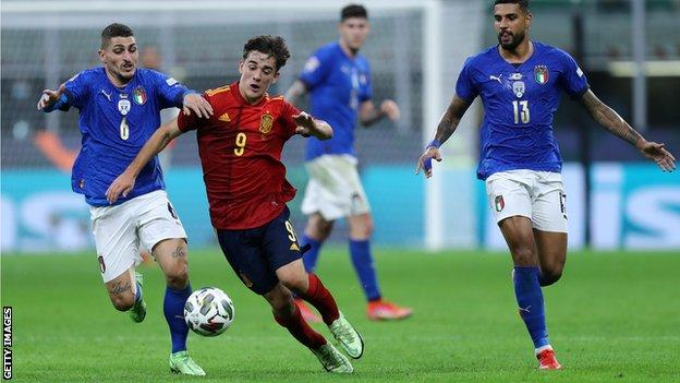 Gavi (centre) in action against Italy