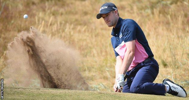 Russell Knox plays out a bunker at Carnoustie